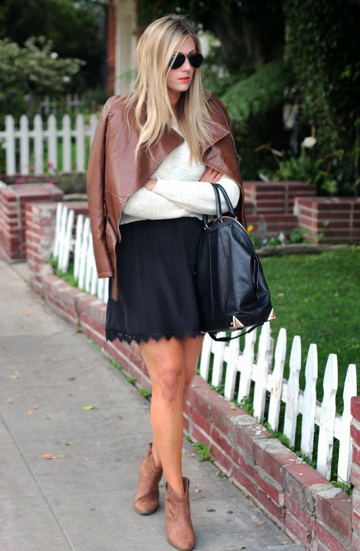 Gorgeous white sleeve blouse with black pleated short skirt and black leather hand bag and brown leather jacket and brown leather warm shoes...