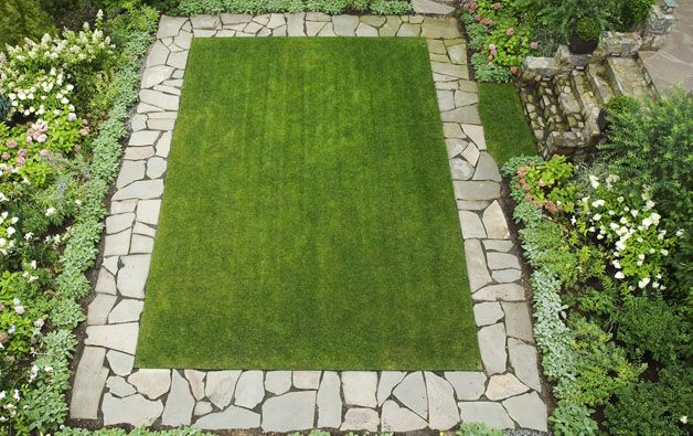 SBG says an ordinary rectangular lawn becomes this beautiful with fragments of recycled concrete laid as a border.  Dig yours out and start today.