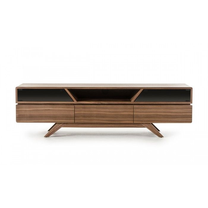 The Soria Walnut TV Stand is an original design by furniture designer Alan Soria. It features a rich walnut veneer finish which is accentuated by the push-open smoked glass doors and sharp geometric shapes of the cubbies. Two drawers pull outward for ample storage while the bottom middle door opens downward. A deep groove encircles the Soria TV Stand and creates a visually pieced together design. User-friendly features include two electrical wire holes at the back of the TV stand that allow…