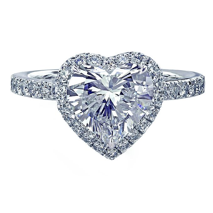 Brides.com: Heart-Shaped Engagement Rings. Platinum halo engagement ring with a 1.78 ct. heart-shaped center stone, $50,00, Leon MegéSee more heart-shaped engagement rings.