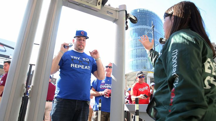 October 9, 2017: NLDS Game 3: Cubs-Nationals recap, social media reaction - Chicago Tribune   - Shawn Green of Cicero goes through a metal detector before the game.