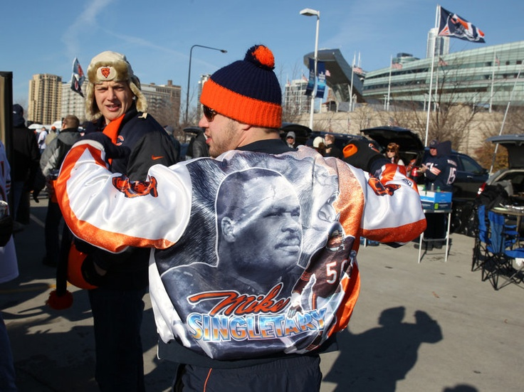 Ryan Lesak of Palos Park displays a jacket with the photo of Bears legend Mike Singletary while tailgating before the start of the Chicago Bears game against the Minnesota Vikings at Soldier Field in Chicago, on Sunday. — Nuccio DiNuzzo, Chicago Tribune, Nov. 25, 2012