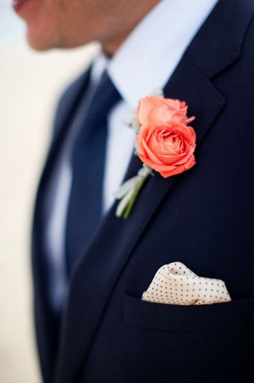 The groom will wear peachy pink spray roses and fresh lavender wrapped in pastel blue ribbon with the stems showing.