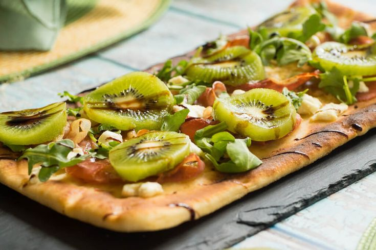 ITALIAN GREEN KIWI FLATBREAD  We know that kiwi's aren't your typical top-of-mind flatbread topping, but you'll love it! Not only is it super easy (phew!), this dish has a ton of flavor from the goat cheese, prosciutto, fresh arugula, and those Kiwis of course! The flatbread only takes a few minutes to bake while your slice up those Italian Green Kiwis. Bon appetito! Find the recipe on Farm Star Living!