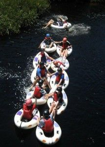 Gravity Adventures - Tubing: The coca-cola coloured waters of the Palmiet tumble through the fynbos-clad slopes of the Kogelberg Biosphere Reserve about an hour's drive from Cape Town. A friendly stream in summer and autumn, while winter rains turn this river into class 2 and 3 whitewater fun. Gravity is equipped to run the river at all levels – we use one person 'gekos' (tubes with a floor and handles) at low levels and inflatable 'crocs' or rafts at higher levels.
