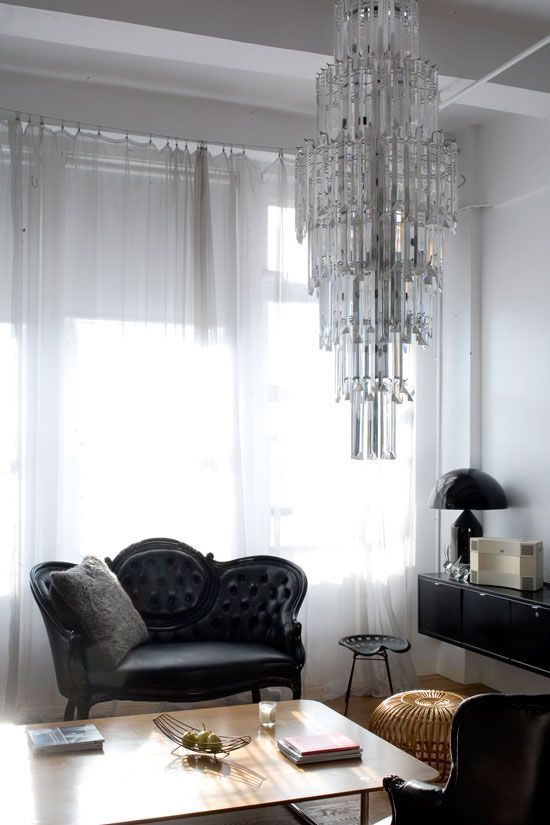 Love the black on black victorian sofa! Also like the tractor seat stool  and chandelier