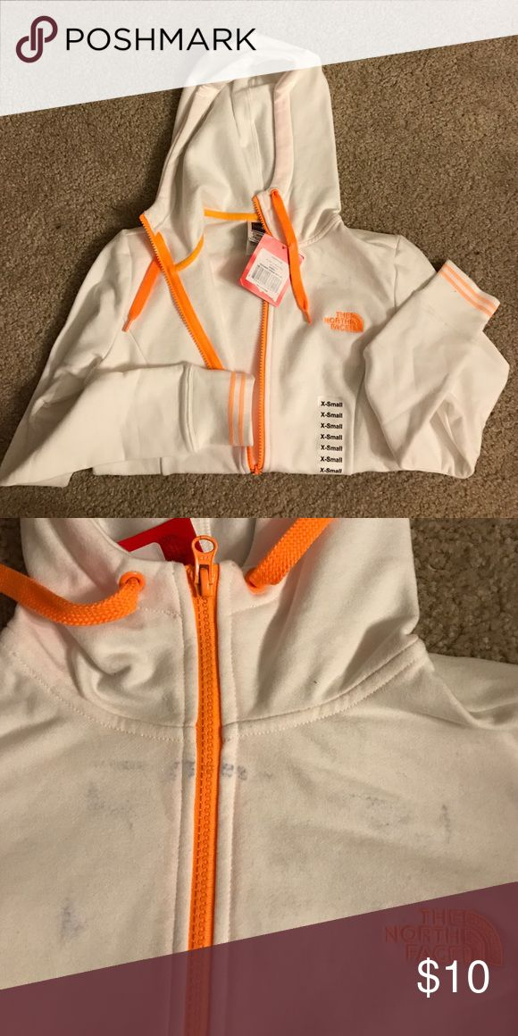 North Face Hoodie BRAND NEW, XS North Face white and neon orange zip up hoodie. Slight blue discoloration on top as shown in picture. No returns! The North Face Tops Sweatshirts & Hoodies