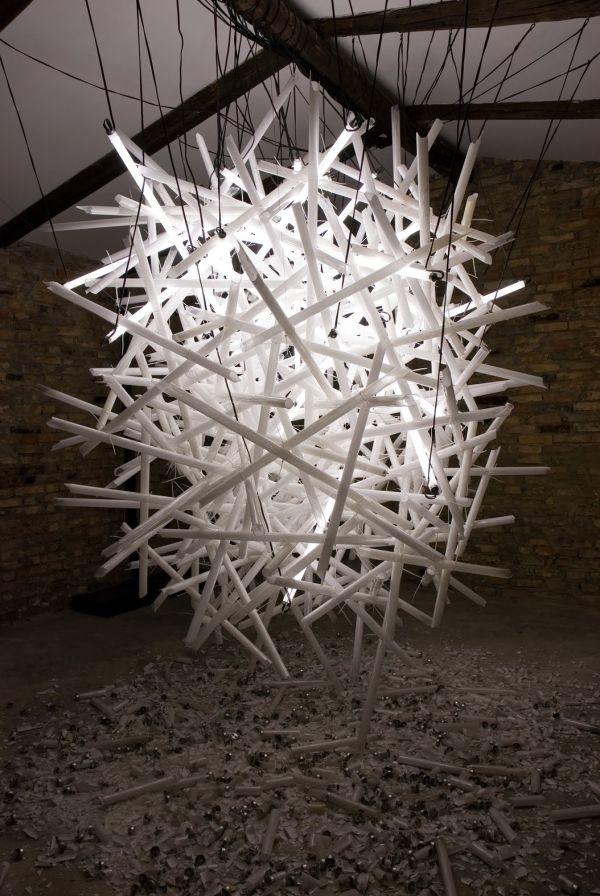 Hitoshi Kuriyama creates elaborate light installations using complex clusters of shattered fluorescent light bulbs.