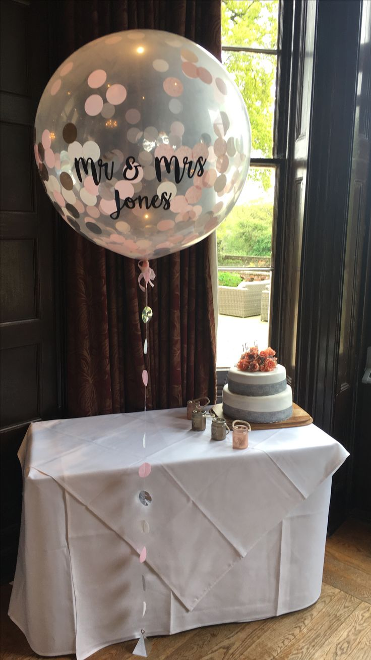 Silver, pink and white confetti giant balloon personalised for newly wed Mr & Mrs Jones at Hartley Lodge Hotel in the New Forest, Hants. Available from The Feather Balloon Company - see website for details