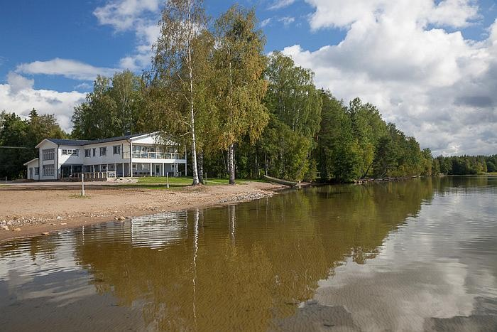 Still water and cloudy sky will invite you to calm down.  #water #cottage #Finland #Aurinkoranta #summer
