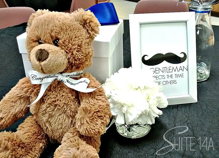 Teddy Bears and Framed artwork make a cute centerpiece for this little gentleman themed baby shower. #mustache #bowtie #suitebaby