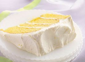 Lemon Velvet Cream Cake Whipped cream and cream cheese create a dreamy frosting and filling for a mix-easy lemon cake.