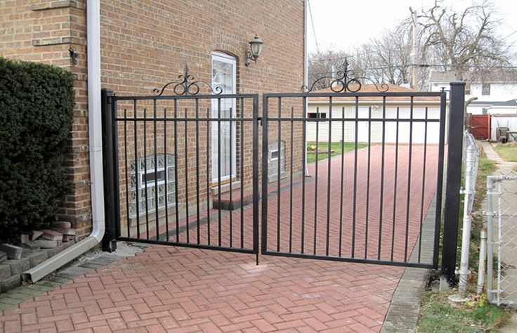 A Custom Driveway Wrought Iron Double Gate Fencing System