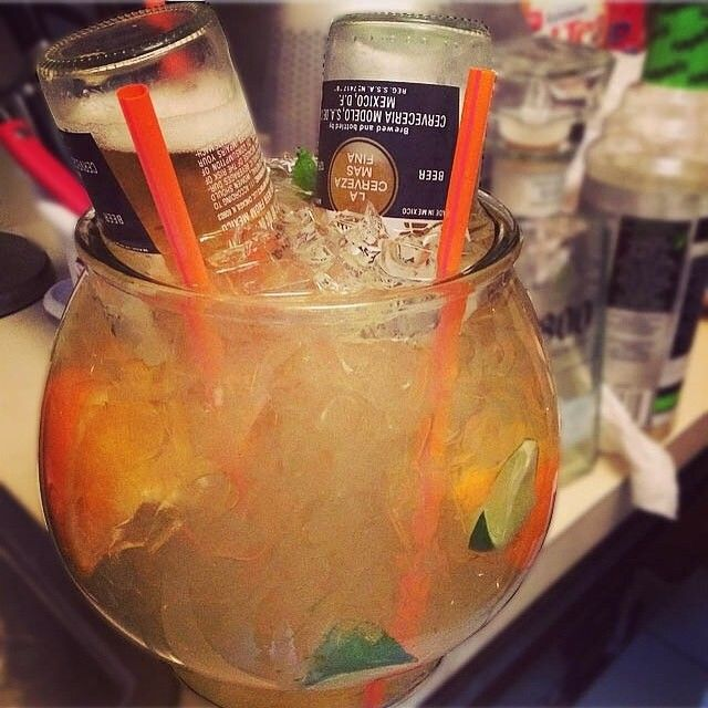 THE BULLDOG FISH BOWL 1 bottle 1800 Coconut Tequila 1 bottle Margarita Mix 4 Fresh Squeezed Oranges 6 Fresh Squeezed Limes 2 (24oz) Corona Bottles  #tequila #1800tequila #corona #drinkporn #cocktail #foodporn #margarita