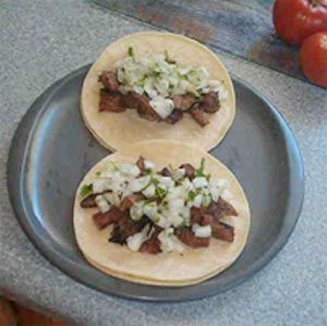 Here are two carne asada tacos. With Carne Asada street tacos - it's all about the meat.    Usually when I make this for family & friends, they're begging for more LOL!  But before I