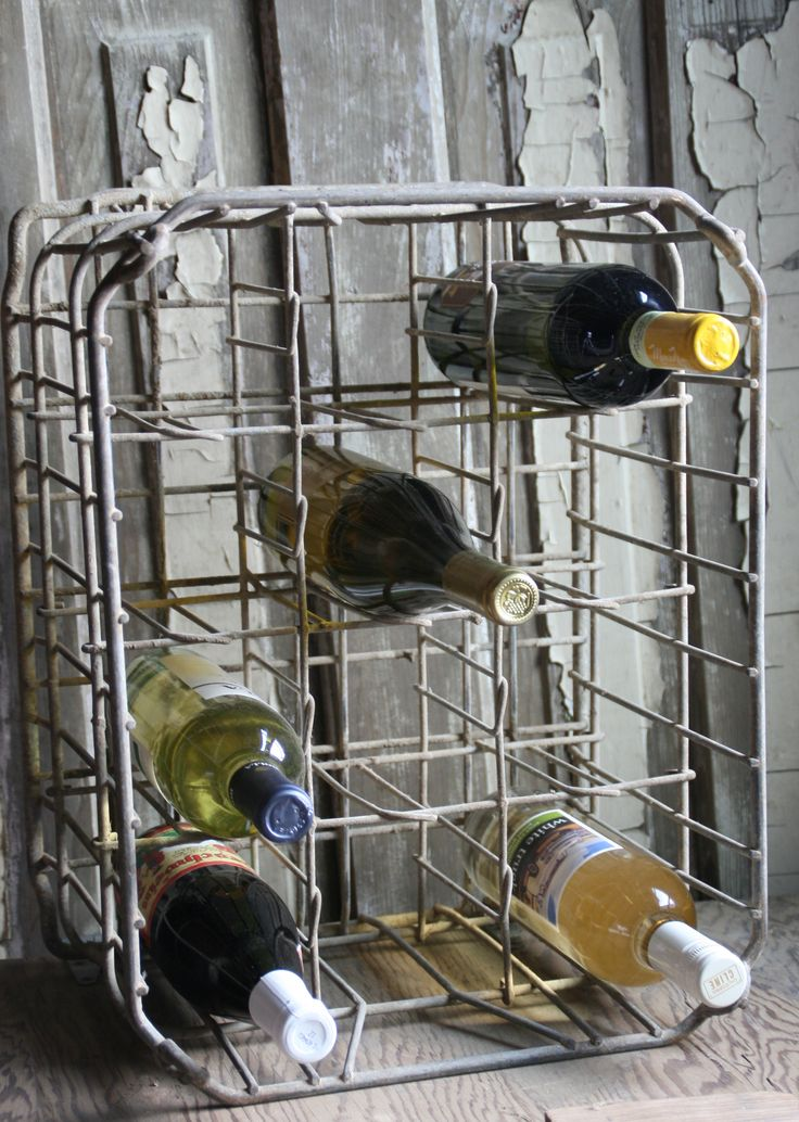Old wire milk crate as wine/liquor bottle holder!  Would also make a great rolled towel rack in bathroom!!