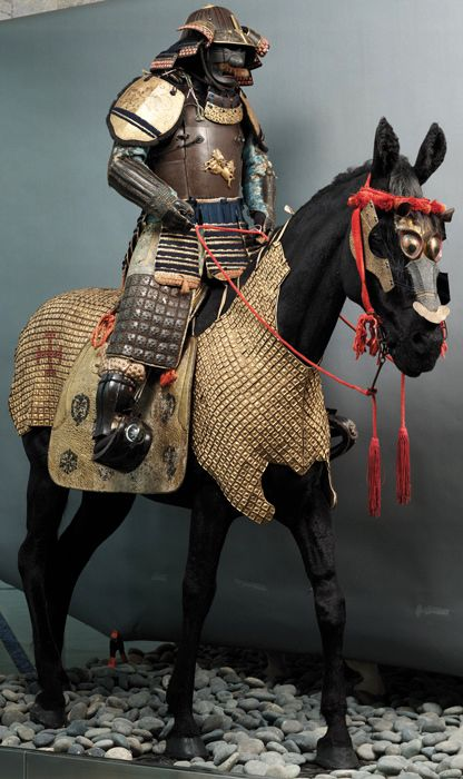 Museum exhibit of samurai on horseback. The samurai and horse armor date to the late 17th/early 18th century. Museum of Civilization, France.