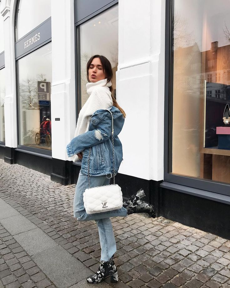 Denim on denim: white knit polo neck, denim jacket and denim jeans. Embellished block heel suede boots. Super chic street wear for this fall season.