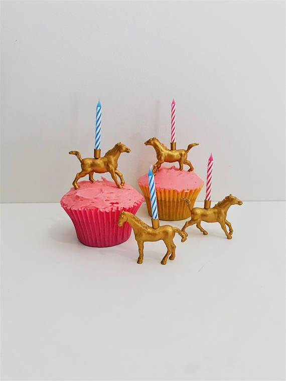This golden horse cake topper holds a candle on its back, it would be such a fun addition to any horse or farm themed birthday party!
