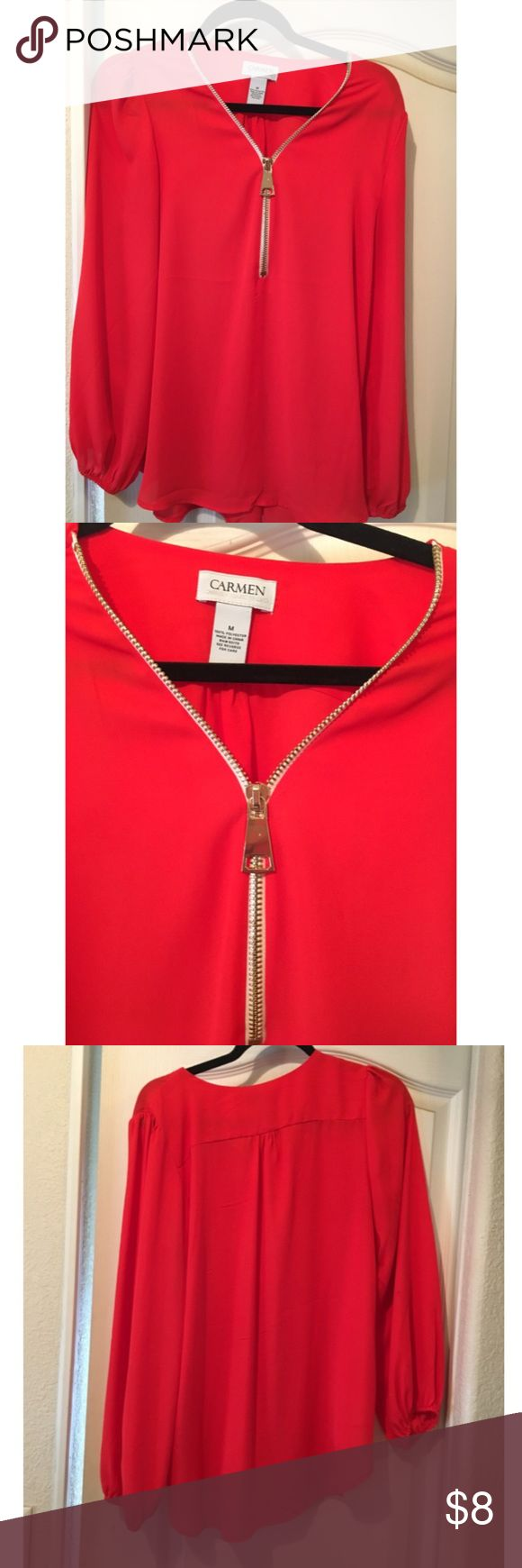 Red Zip Front Blouse super sexy sz M Popping coral red Zip up Blouse. The Zipper is fully functional so if you want to make this extra sexy. Features big gold Zipper accent. Size Medium or can fit a large. Very form flattering sits nicely on your hips. Elegant flowy sleeves. Original owner, non smoker. No stains or rips. Check out my other items and bundle and save!!! I ship within 24 hours! 🛍👜💥 (similar brands: Forever 21, H&M, Zara, Express) posted as Bebe for exposure. bebe Tops…