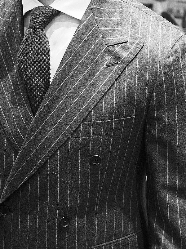 Double breasted pinstripe suit.