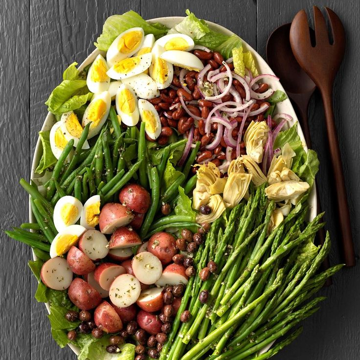 Veggie Nicoise Salad Recipe -More and more people in my workplace are becoming vegetarians. When we cook or eat together, the focus is on fresh produce. This salad combines some of our favorite ingredients in one dish...and with the hard-boiled eggs and kidney beans, it delivers enough protein to satisfy those who are skeptical of vegetarian fare. —Elizabeth Kelley, Chicago, Illinois #Vegetariancooking