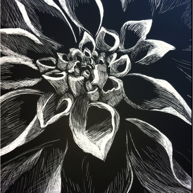 A flower on scratch art board that I did