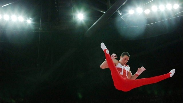 Kristian Thomas of Great Britain competes on the horizontal bar - 2012