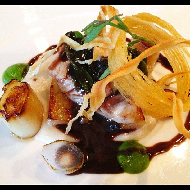 Sea Bass from Eyemouth poached in red wine w salsify, spinach, winkles & seaweed from the Isle of Bute, The Kitchin Restaurant in Edinburgh Scotland