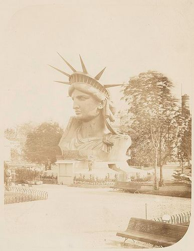 Head of the Statue of Liberty on display in a park in Paris.