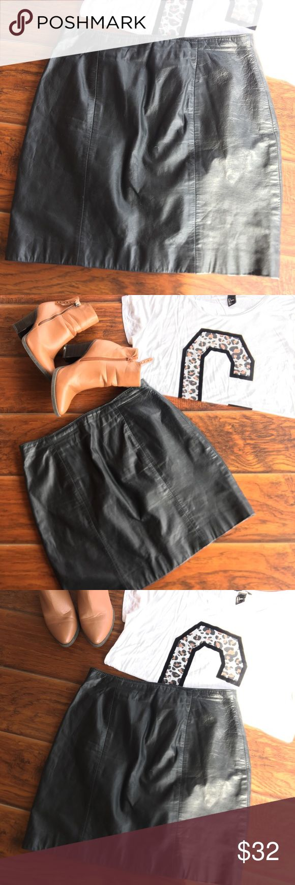 """Wilson's  Leather Black Mini Skirt. Wilson's Leather Black Mini Skirt •Sz: 12 •100% Leather •Pre-owned Good  condition. •zipper in the back part  Approx. measurements laying flat down and in inches: Waist: 15"""" Length: 17.5"""" Leg opening:19"""" Wilsons Leather Skirts"""