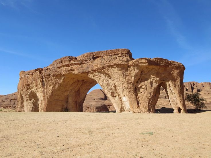 Five Arch Rock is a sandstone feature of the Ennedi Mountains in Chad, Central Africa.