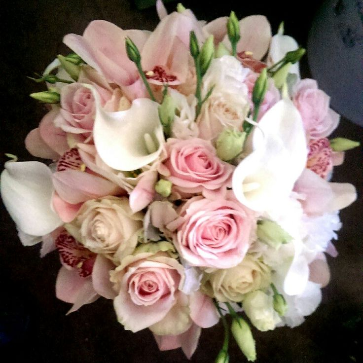 Sweet roses, Cymbidium Orchids and tiny white calla lilies in a posy bouquet
