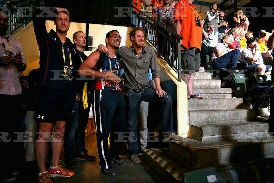 Invictus Games, Orlando, America - 10 May 2016  Prince Harry watches USA and GBR sitting volleyball teams compete in the finals with USA athlete Michael Kacer during the Invictus Games 10 May 2016