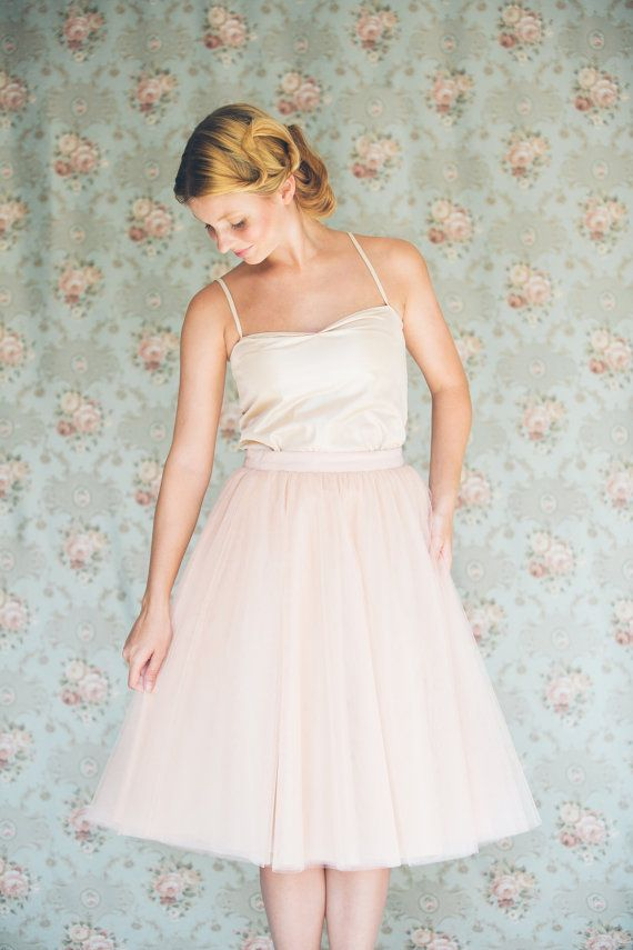 This beautiful blush pink knee length tulle skirt is a staple , a must have for your wardrobe. The skirt is made with 5 layers of bright pink