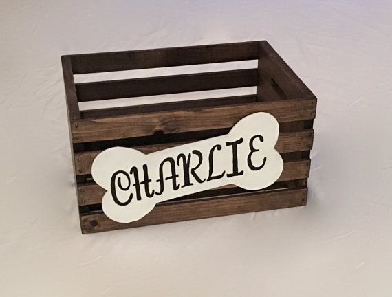 This Personalized Dog Toy Box is a wooden crate with a bone shaped name plate attached to the front. This crate is sturdy and durable. This makes for the perfect storage container for many dog toys, leashes, etc... Great gift idea for someone with a dog or new puppy. Contact me for