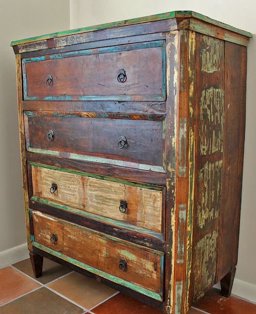 After we strip the teal and turgouise paint we've all been going crazy with... Painted Furniture
