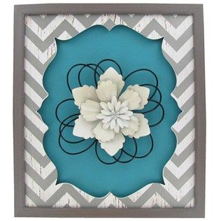 Add flare to décor with this Turquoise, White & Gray Chevron Wall Plaque with Flower. The MDF wall plaque has a chevron print pattern and is embellished with a layered metal flower. Hang it horizontal or vertically with the attached hanging hardware.