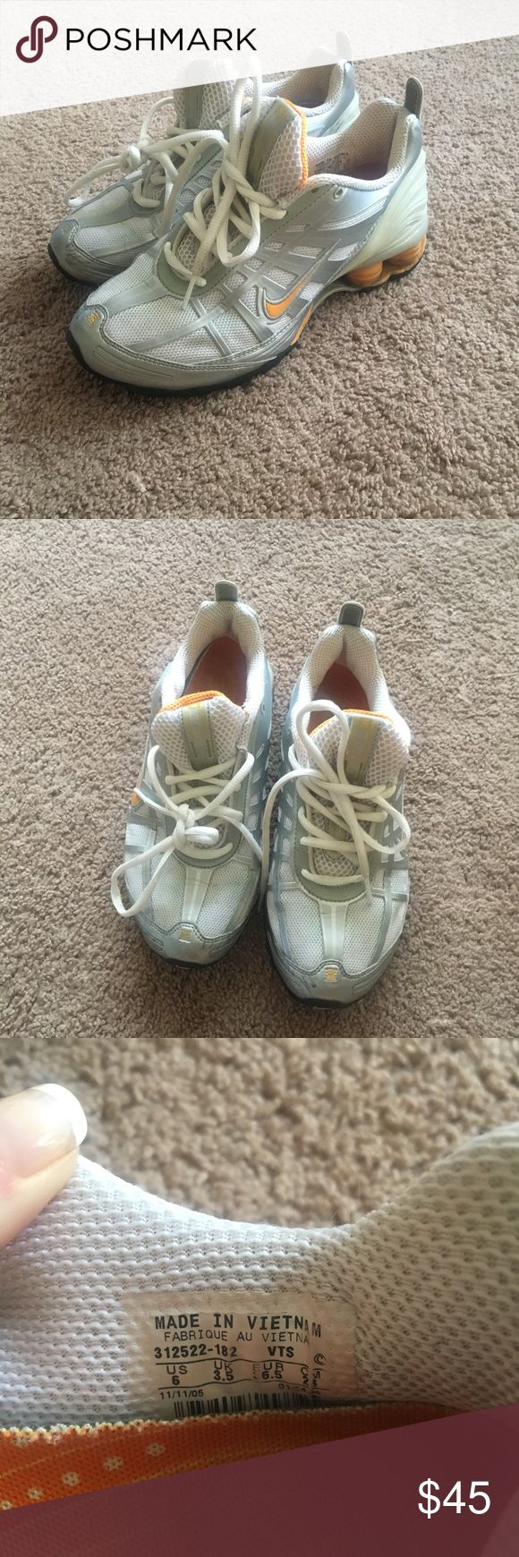Nike Women's running sneakers. Size 6. White and silver with light orange accents. Worn a few times. Overall clean and in good condition. Nike Shoes Sneakers