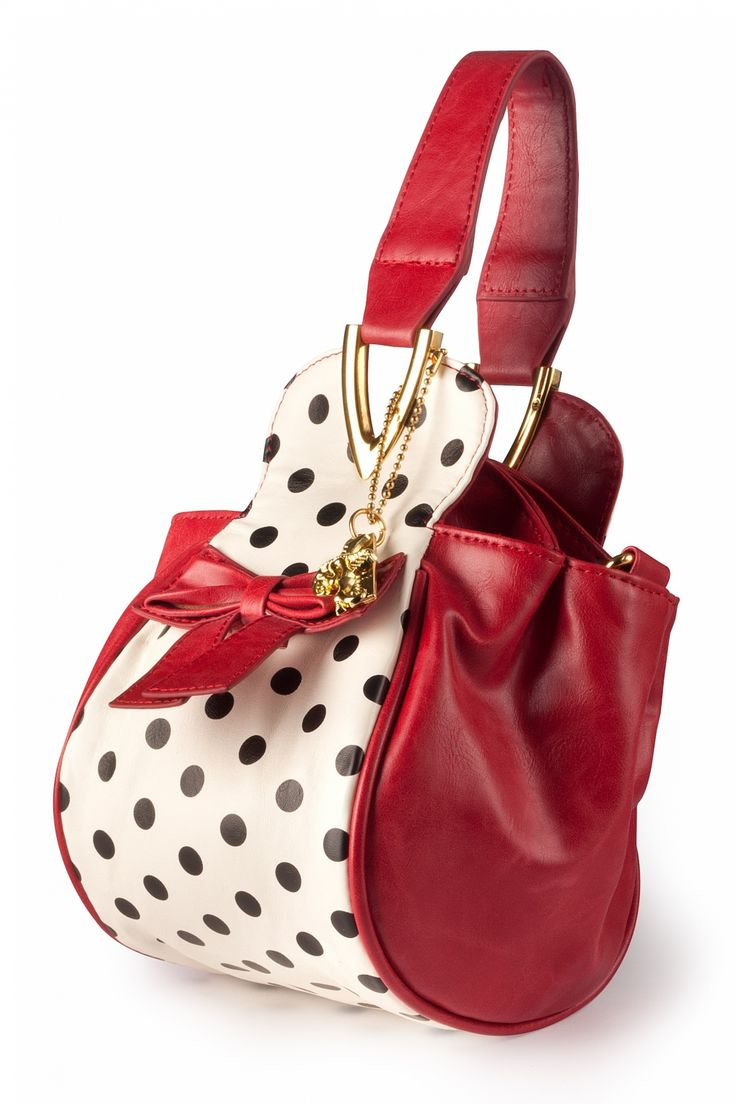 New collection! Boatie Red White Black Polka Dot handbag / shoulder bag from Lola Romana. Fun little bag in red faux leather with cream and black polka dots and a cute bow at the front.Made of a high quality artificial leather. You can carry it in your hand of on / cross shoulder with the adjustable shoulder straps to keep your hands free. Small but very handy with 4 separate compartinents which are closed by magnet pushbuttons.