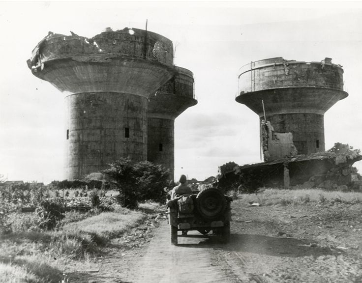 These three enormous flak towers guarded a German Marine base near Angers, France. Each tower would have been armed with several large caliber and small caliber anti-aircraft guns. They were destroyed by Allied air attacks as General Patton's 3rd Army advanced East.