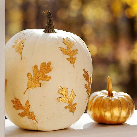 Bring beautiful shine to your home this Halloween with a pair of pretty metallic pumpkins. Collect fallen leaves and spray-paint them gold; let dry. Paint one pumpkin white and the other gold. When dry, use crafts glue to attach the metallic leaves to the white pumpkin, then arrange the pair together on your porch or front step.