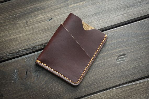 Do you like to keep your cards and cash in your pocket? Looking for something minimalist, but robust? This card & cash holder maintains a slim profile and can expand to as many cards as you want to cram into it.  ► Water resistant chromexcel leather treated with hot-stuffed with tallow and waxes ► Burnished and polished edges ► Hand sewn with imported Tiger Thread and saddle stitched: stronger than machine stitch. ► Fits up to 5 cards (more if you work in the leather) in the main pocket ►…