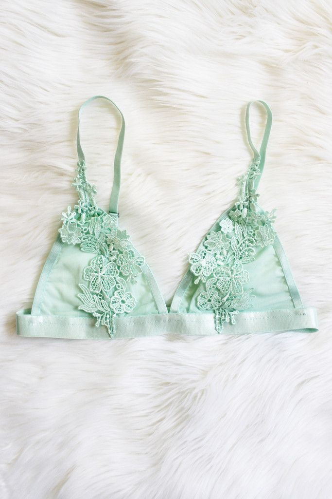 """Details Size Shipping • 100% Polyester • Floral appliqué triangle bralette; adjustable. • Hand Wash • Line dry • Imported • Measured from small • Length 10"""" • C"""