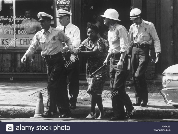 Download this stock image: Birmingham 1963 Ethel Witherspoon is arrested by Birmingham police including chief Jamie Moore in the necktie - A0GA2B from Alamy's library of millions of high resolution stock photos, illustrations and vectors.