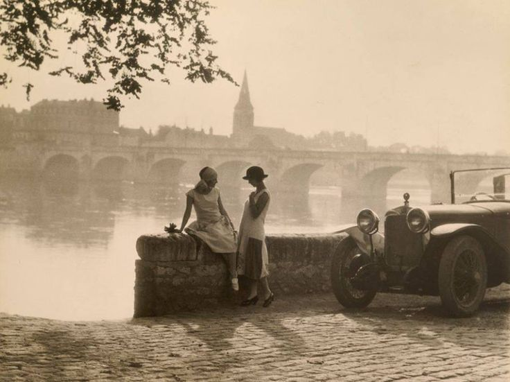 Photographer H. Armstrong Roberts captured this image of women sharing a conversation along the Loire River in Saumur, France, in 1928.