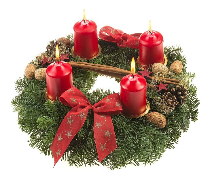 Real fir Advent wreath with four red candles, decorative bows, walnuts, hazelnuts, cinnamon and pine cones. Available from Amazon.de