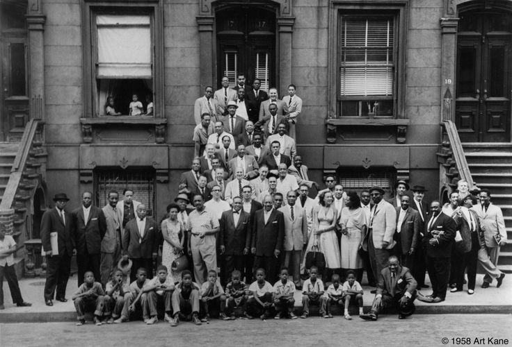 """""""A Great Day in Harlem"""":  Famous jazz musicians, including Count Basie, Art Blakey, Art Farmer, Dizzy Gillespie, Benny Golson, Coleman Hawkins, Gene Krupa, Charles Mingus, Thelonious Monk, Gerry Mulligan, Oscar Pettiford, Sonny Rollins, Jimmy Rushing, Horace Silver, and Lester Young"""