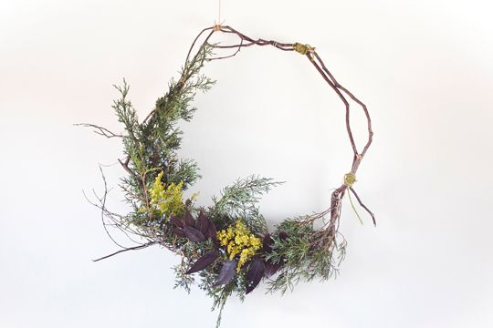 collected foliage, winter berry, twigs, and twine.