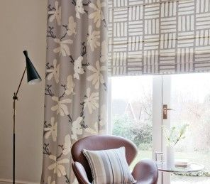 These Clarke & Clarke Malva Roman Blinds bring a natural tone to your home with a geometric pattern!